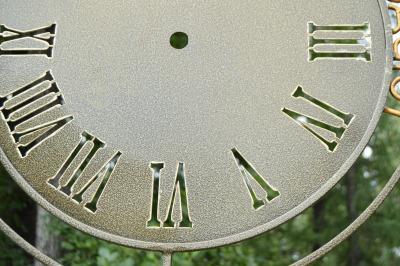 Dial vintage wall clocks, closeup dial with Roman numerals