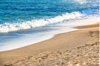 Beautiful beach with sand and blue water in the sun