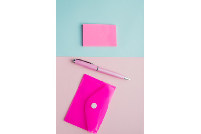 Creative vertical flat lay, top view, office space stationery on pink