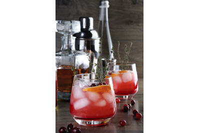 Cocktail Cranberry Orange Bourbon Smash with a spicy hint of thyme