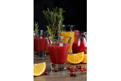Freshly prepared cranberry fruit-drink with orange juice and a sprig o