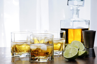 Alcohol cocktail with brandy, whiskey or rum, lime and ice in glasses