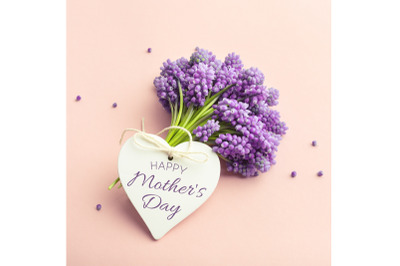 Spring violet flowers and heart shape card Happy Mothers Day