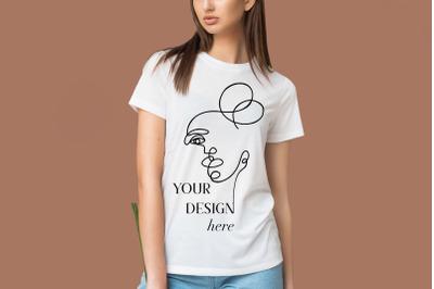 Female white t-shirt mockup on the beige background