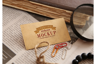 Photorealistic mock-ups with old book and papers on background