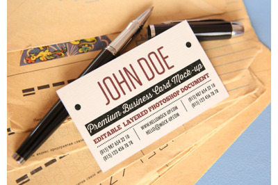Business card template with pens and old antique envelopes background