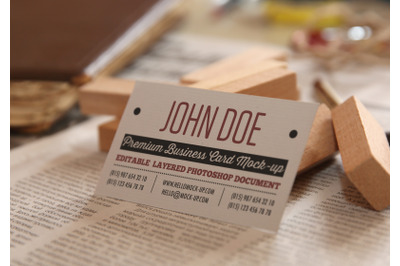 Business card template on letters on newspapers background