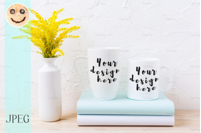 Two white coffee and cappuccino mug mockup with ornamental grass