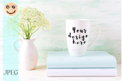 White cappuccino mug mockup with wild meadow flowers in pitcher