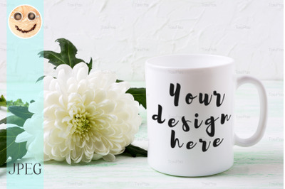 White coffee mug mockup with chrysanthemum