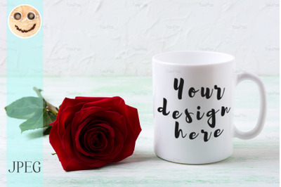 White coffee mug mockup with dark red rose