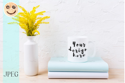 White coffee mug mockup with ornamental yellow flowering grass