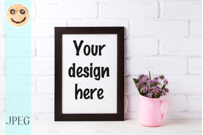 Black brown  frame mockup with purple flowers in polka dot pink pitche
