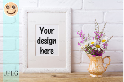 White frame mockup with chamomile and purple flowers in golden pitcher