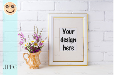 Gold decorated frame mockup with chamomile and purple flowers in golde
