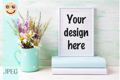 White frame mockup with chamomile and purple flowers in vase