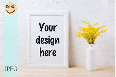 White frame mockup with ornamental yellow flowering grass in vase