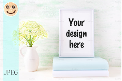 White frame mockup with pale mint book