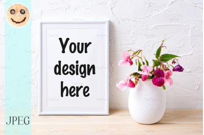 White frame mockup with pink house plants in flowerpot