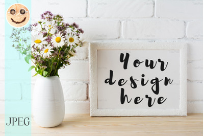 White landscape frame mockup with blooming wildflower bouquet in vase