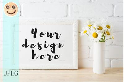 White landscape frame mockup with daisy flower in styled vase