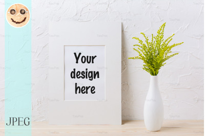 White mat frame mockup with ornamental grass in exquisite vase