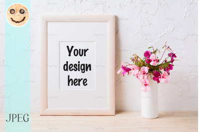 Wooden frame mockup with pink and purple flower bouquet