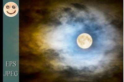 Full moon over dark cloudy sky