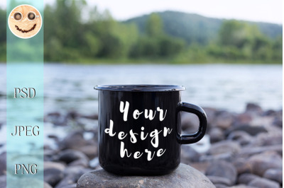 Black campfire mug mockup with stony river bank