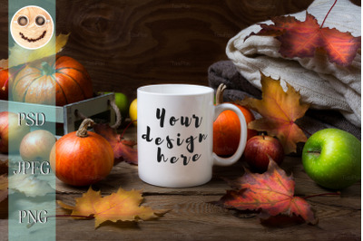 White coffee mug mockup with fall leaves, pumpkins