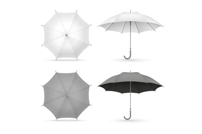 White and black realistic umbrellas isolated on white background