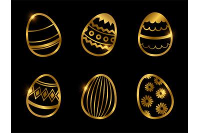 Golden decorative eggs icons isolated on black background