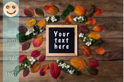 Wooden square picture frame mockup with fall leaves
