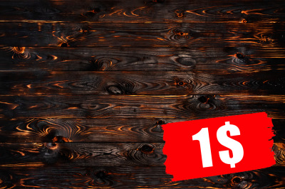 Burnt wooden board, black charcoal wood texture, burned background