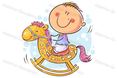 Little child riding a toy horse