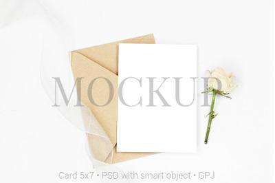 Mockup invitation card with envelope, rose and ribbon