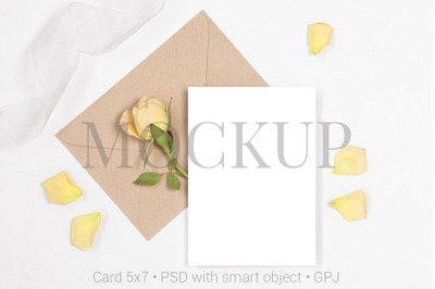 Mockup invitation card with envelope, rose and petals