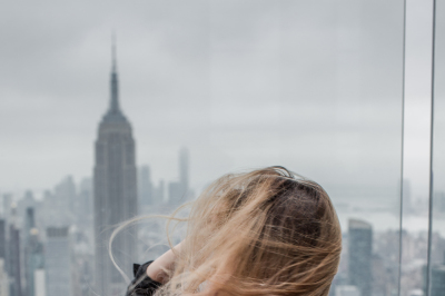 Girl on a windy day watching manhattan