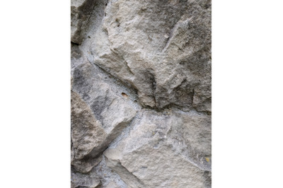 Grey stone cement wall background stonewall rubble facade closeup