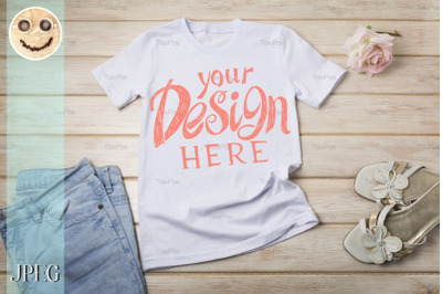 Womens T-shirt mockup with rose and sandals.