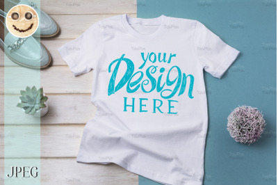 Womens T-shirt mockup with turquoise loafers.