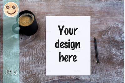 Blank paper sheet mockup with cofee mug.