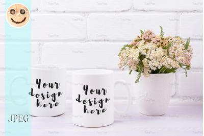 Two coffee mug mockup with pink beige wild flowers.