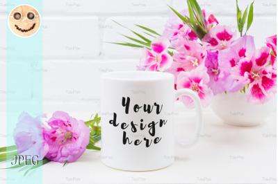 White coffee mug mockup with pink godetia flowers.