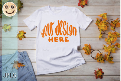 Unisex T-shirt mockup with fall leaves.