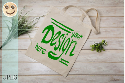 Tote bag mockup with green grass.