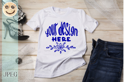 White womens cotton T-shirt mockup with black sandals.