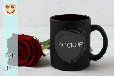 Black coffee mug mockup with red rose