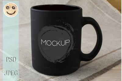 Black coffee mug mockup on the linen napkin.