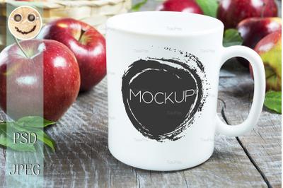 Coffee mug mockup with apples.